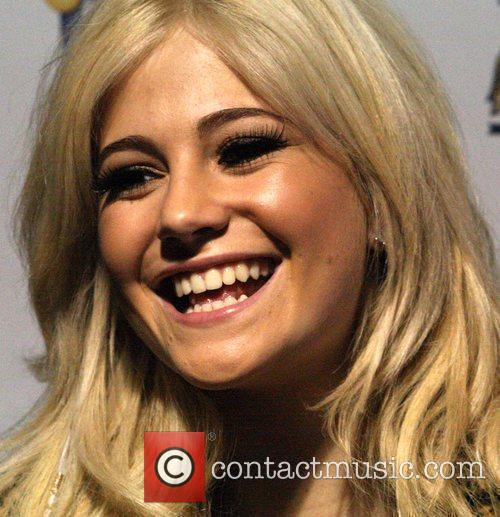 Pixie Lott attends the switching on of the...