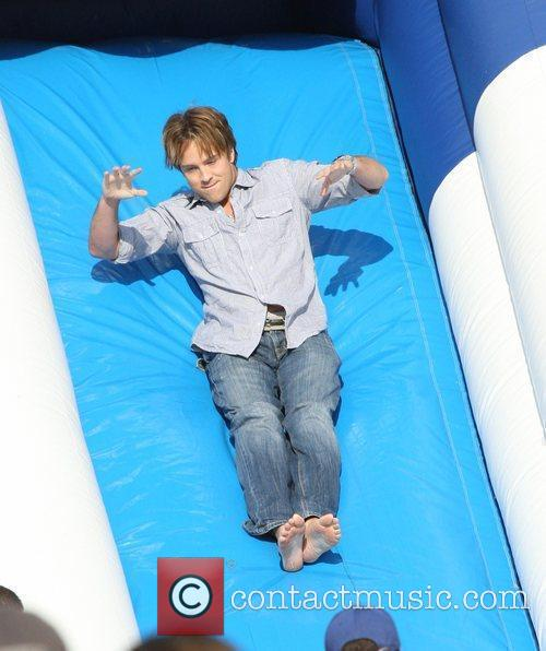 Larry Birkhead enjoys a ride on a bouncy...