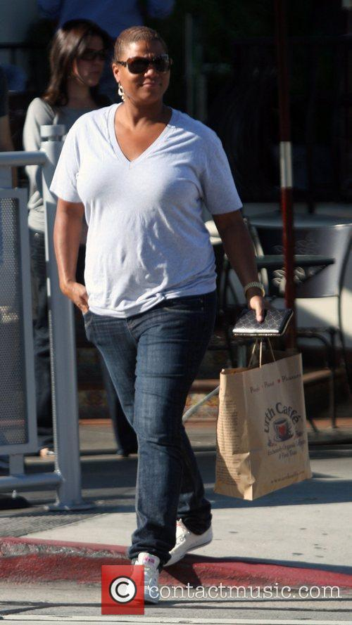 Queen Latifah picks up some food from the...