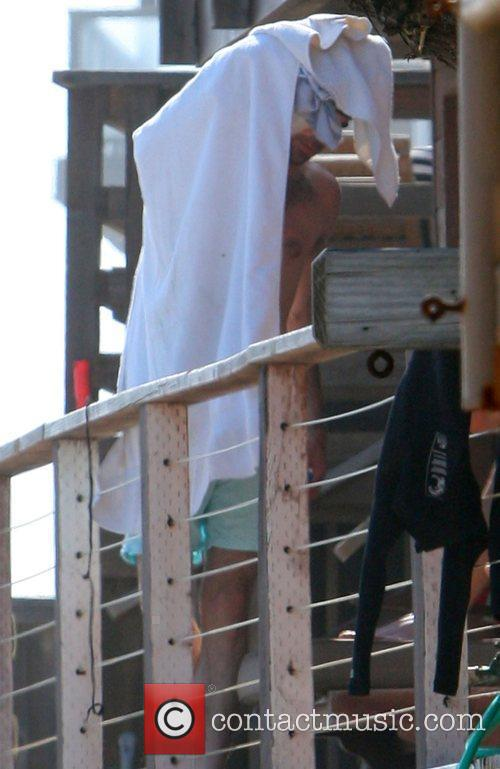 Zachary Quinto on the beach in Malibu with...