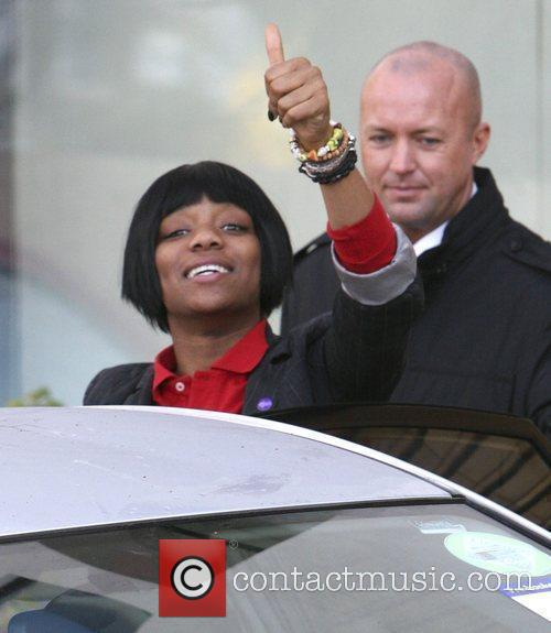 Rachel Adedeji gives a thumbs up and a...