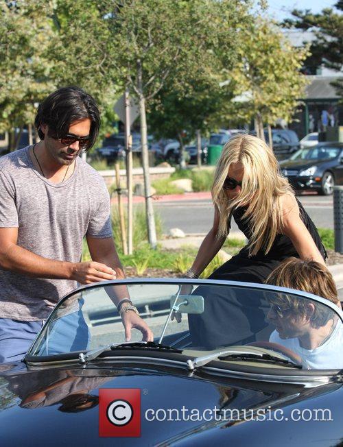 American Fashion Stylist Rachel Zoe Getting Into A Convertible Sports Car In Cross Creek 6