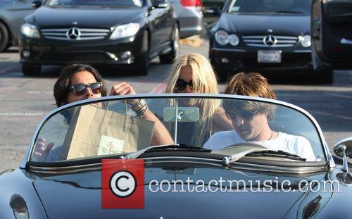 American Fashion Stylist Rachel Zoe Getting Into A Convertible Sports Car In Cross Creek 7