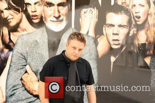 Poses for photographs at the opening of his...