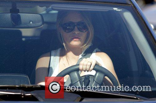 Rebecca Gayheart leaving La Conversation after having lunch....