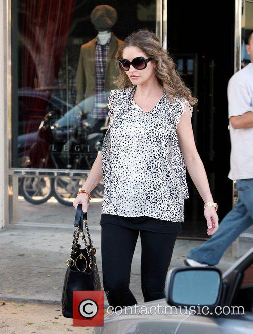 Rebecca Gayheart wearing flip flops and a loose...