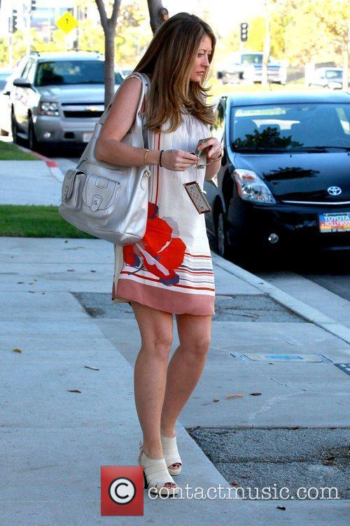 Running errands before arriving at the Beverly Hills...