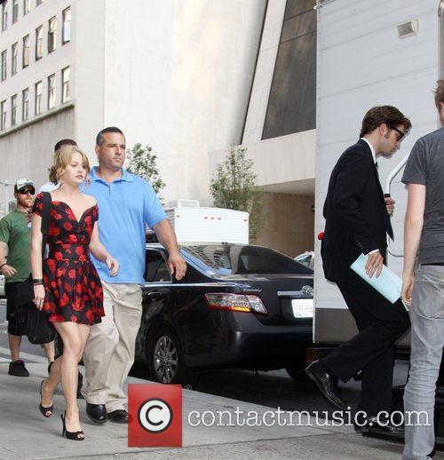 Emilie de Ravin and Robert Pattinson on the...