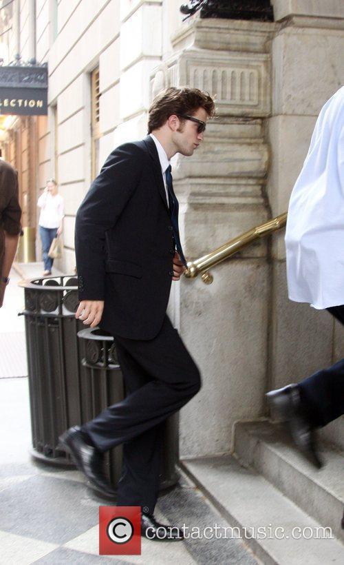 Robert Pattinson on the set of her new...