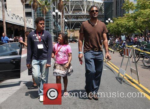 Takes his children to Comic Con