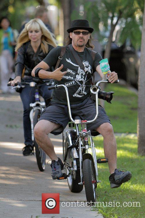 Rick Mendoza enjoys a bike ride - he...