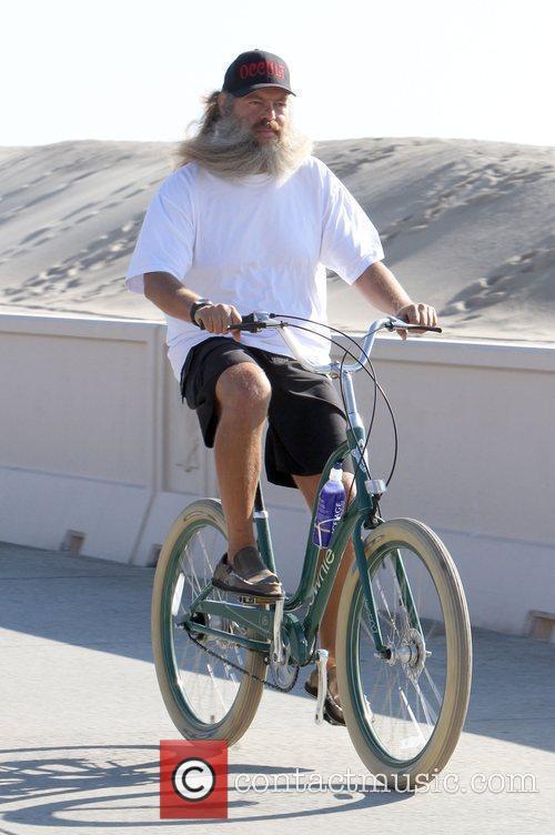 Riding his bike along the beach
