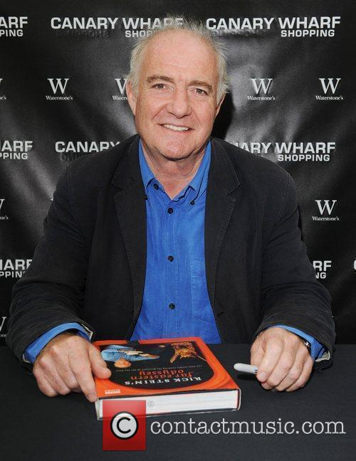 Rick Stein  signs copies of his book...
