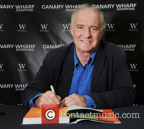 Signs copies of his book 'Rick Stein's Far...