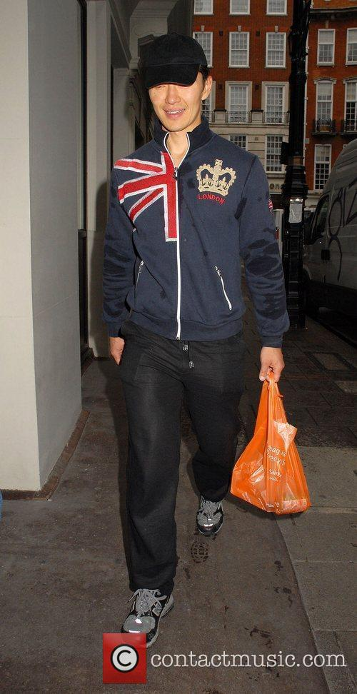 Rick Yune, wearing a Union Jack print jacket,...