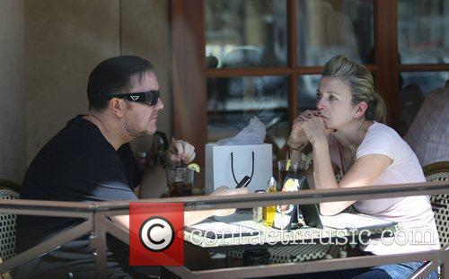 Ricky Gervais with his partner, Jane Fallon, having...