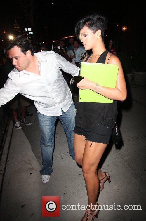 Leaves her Soho hotel holding a green folder