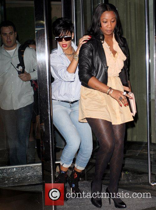 Rihanna leaving her Manhattan hotel while wearing colourful...