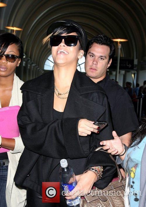 Arrives at LAX airport to catch a flight