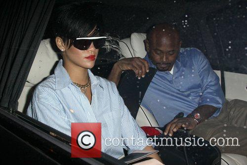 Rihanna leaving Scalinatella restaurant sporting a large black...