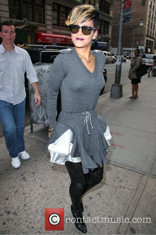 Rihanna arrives at a SoHo building in style,...