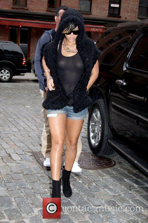 Rihanna out and about in Soho while wearing...