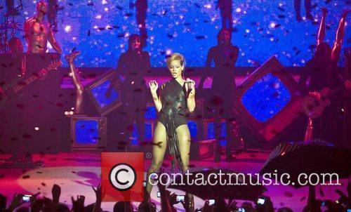 Performs on stage during the launch party for...