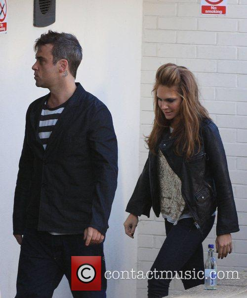 Robbie Williams arrives at a TV studio to...