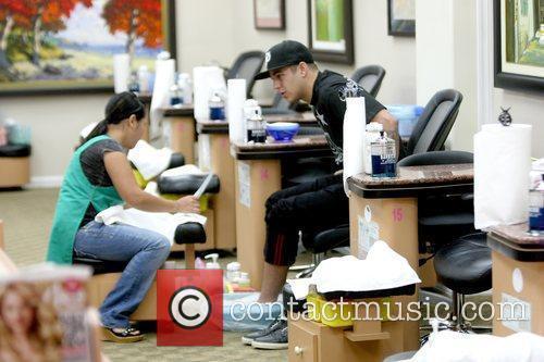Robert Kardashian  getting a pedicure at a...