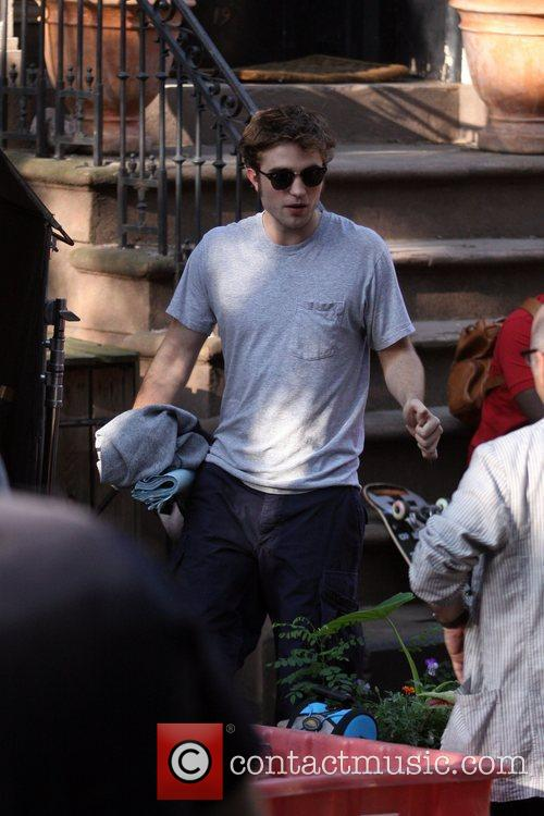 Robert Pattinson filming on the set of his...