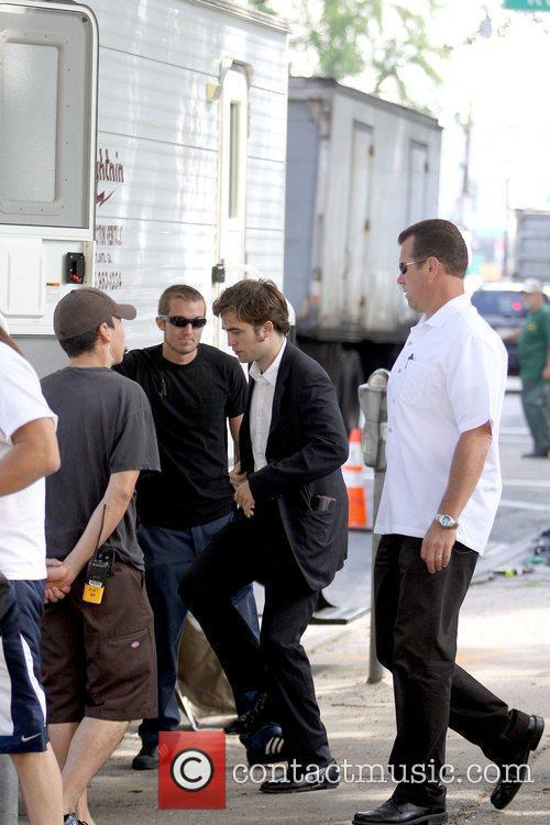 Robert Pattinson  returns to his trailer while...