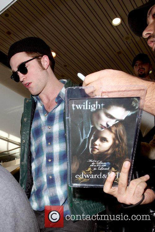 Robert Pattinson denying a fan an autograph while...
