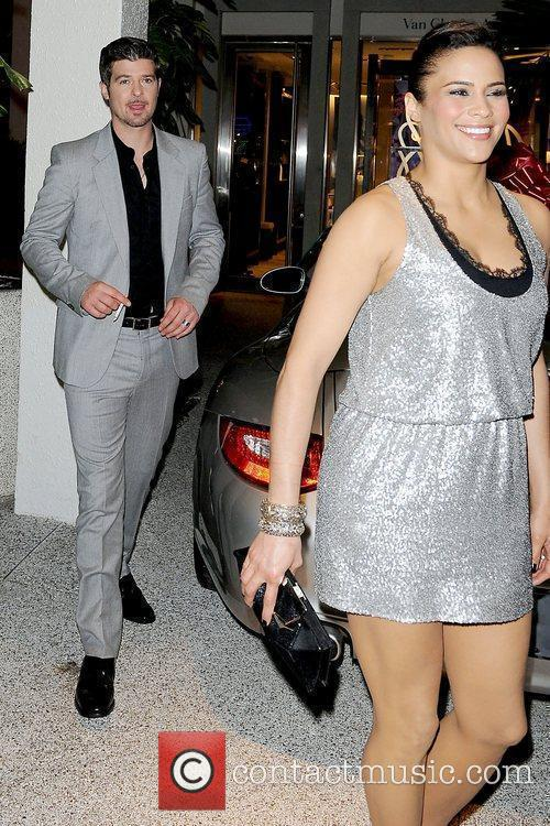 Robin Thicke and Paula Patton Roger Vivier Boutique...