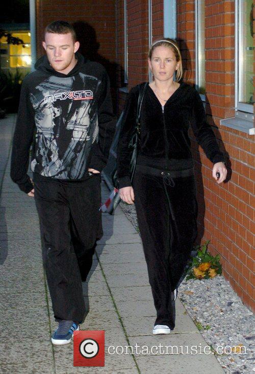 Leaving Liverpool Women's Hospital as Wayne and Coleen...