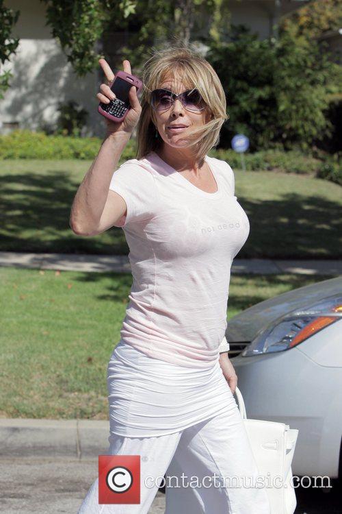 Rosanna Arquette leaves Le Pain Quotidien after having...