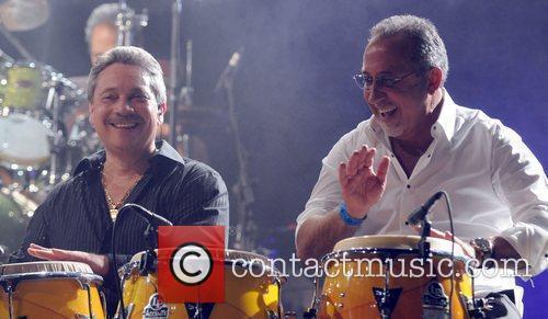 Emilio Estefan performing on stage with Ruben Blades...