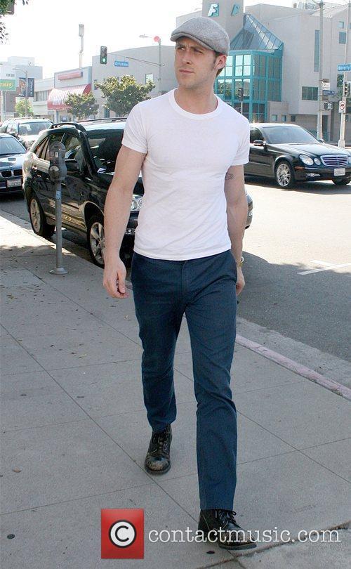 Ryan Gosling running errands while wearing a gray...