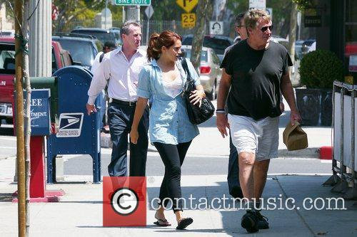 Ryan O'neal Takes Food To Go After Having Lunch With A Friend 3
