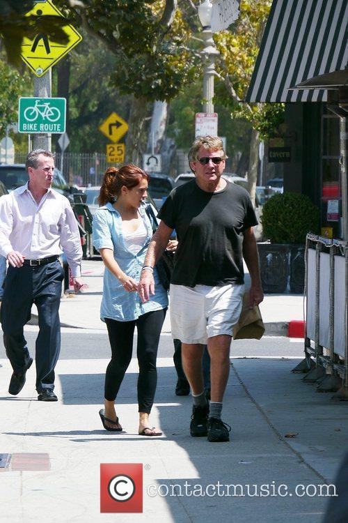 Ryan O'Neal takes food to go after having...