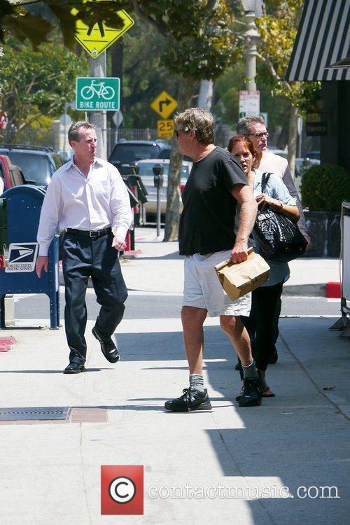 Ryan O'neal Takes Food To Go After Having Lunch With A Friend 5