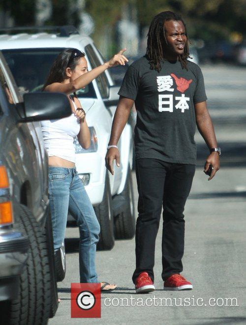 Sal Masekela  with a female friend in...