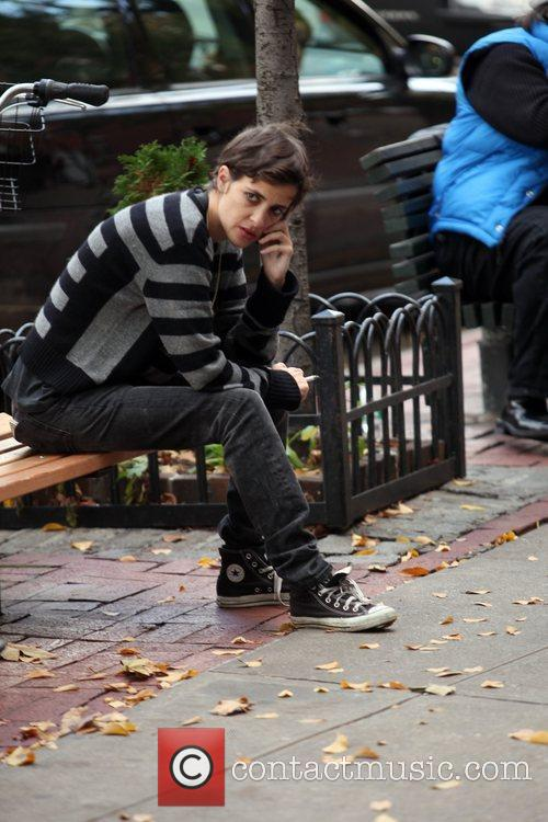 Samantha Ronson sitting on a bench and talking...