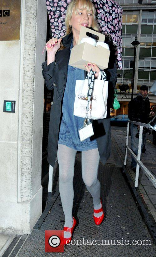 Outside BBC Radio One studios with her hands...