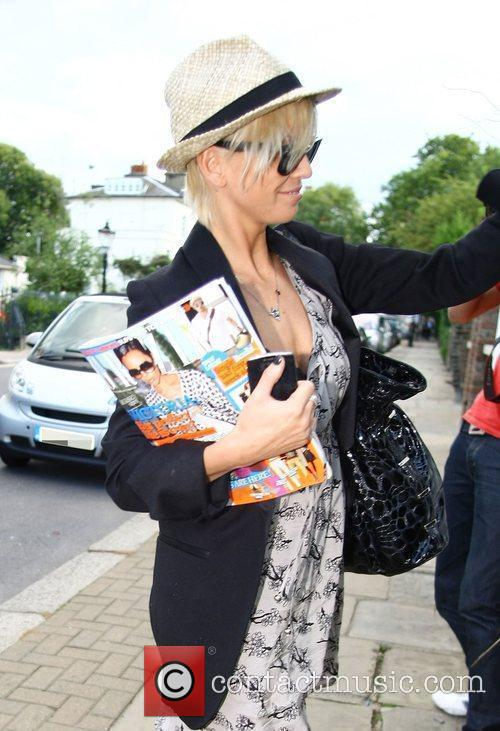 Arriving home carrying a copy of Grazia magazine...