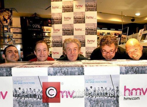Folk rock band sign copies of their best...