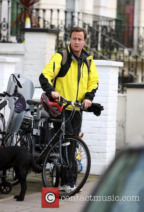 David Cameron heads home on his bike after...
