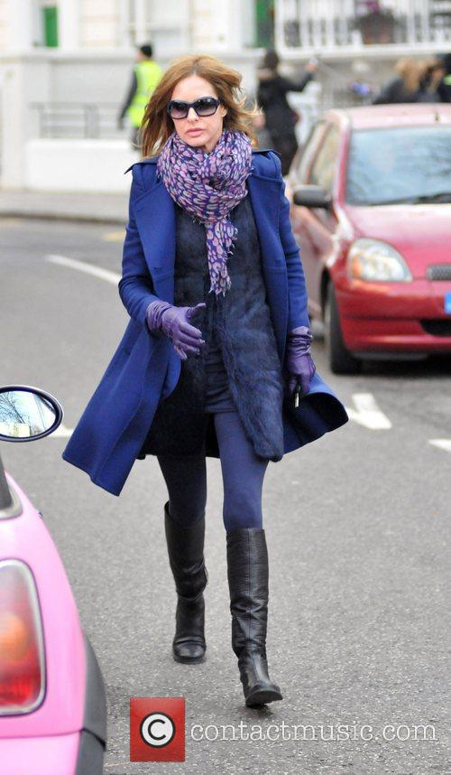 Trinny Woodall returns to her car after dropping...