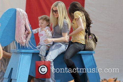 Renee Sloan with her daughters visit Mr. Bones...