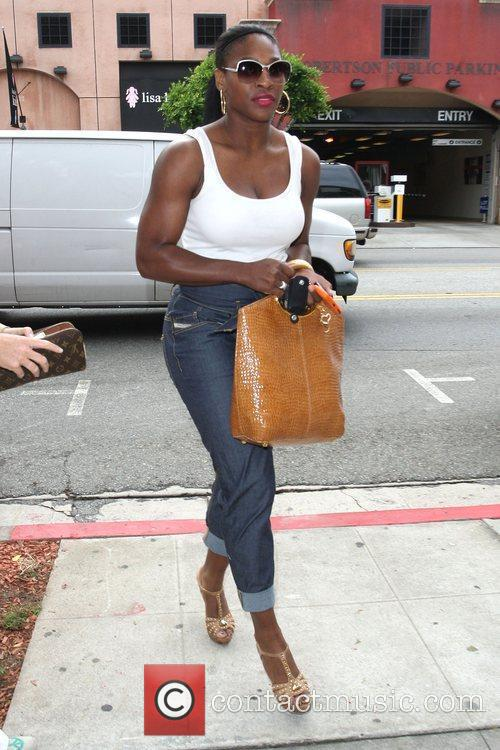 Serena Williams seen shopping for jeans at designer...