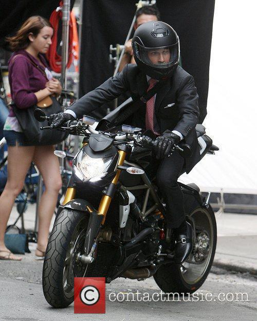Rides a motorcycle on the movie set for...